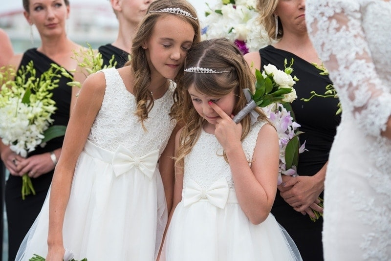 Wedding Photography, little girl wiping away a tear during ceremony