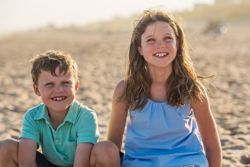 Family Photography, brother and sister posing at the beach