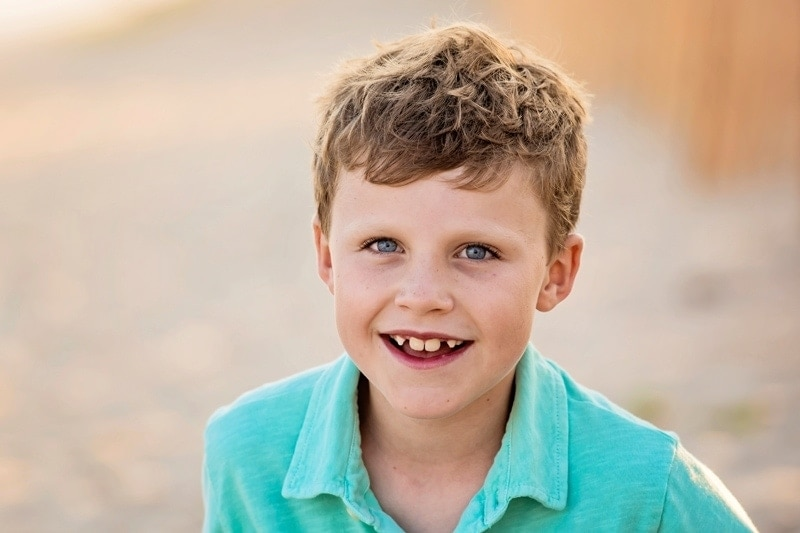 Family Photography, close up of little boy in blue green polo
