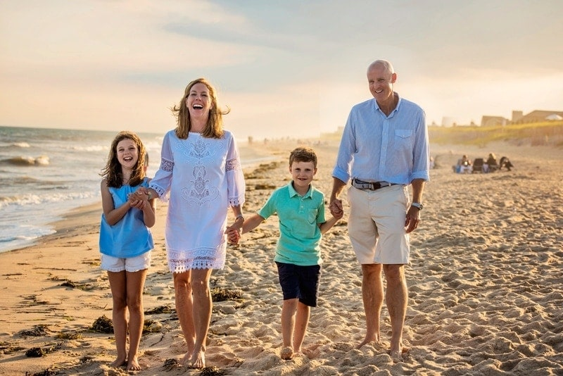 Family Photography, family of 4 walking on the beach