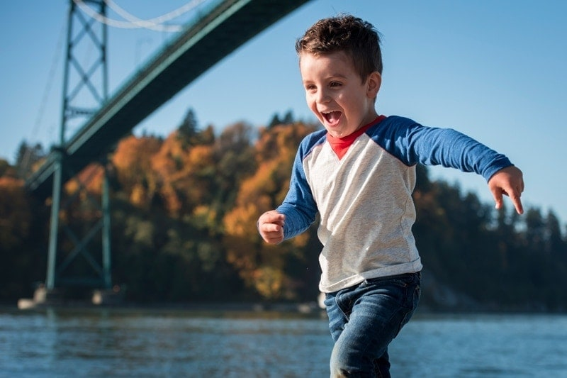 Family Photography, little boy running next to river