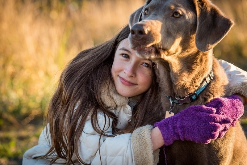 Family Photography, young girl hugging dog