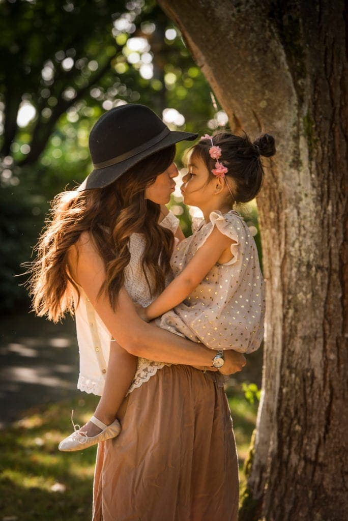Vancouver Family Photography, mother holding daughter up for a kiss