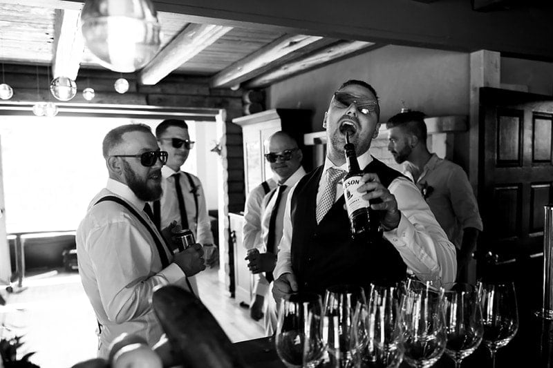 Wedding Photography, groomsmen having drinks before the ceremony