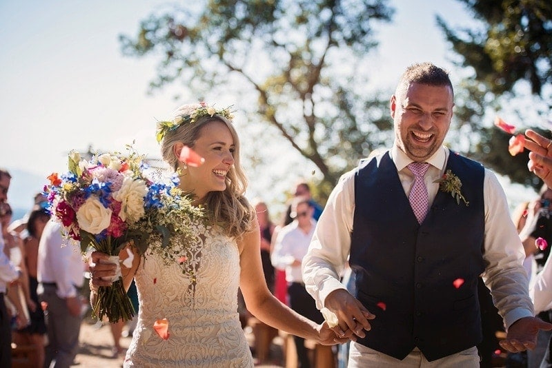 Wedding Photography, couple smiling and laughing as they walk back up the aisle