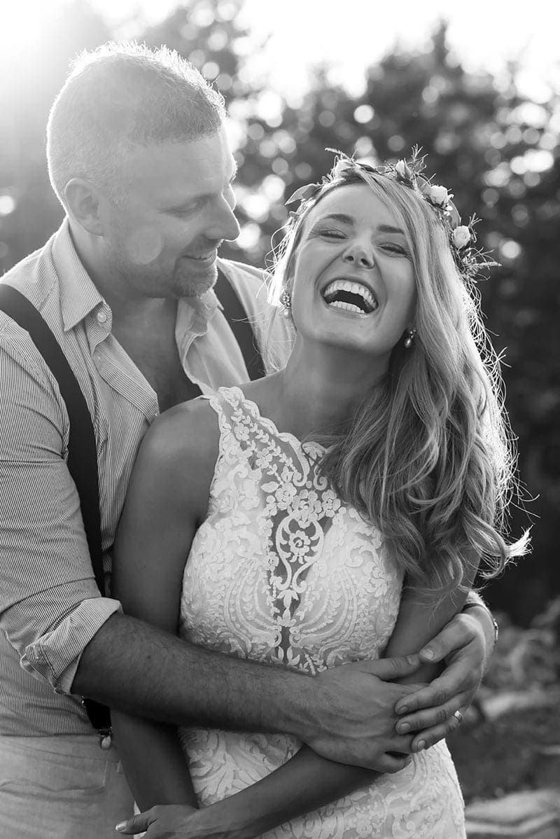 Wedding Photography, black and white of couple laughing together