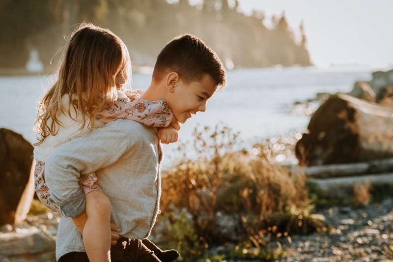 Vancouver Family Photography, brother giving sister a piggy back ride