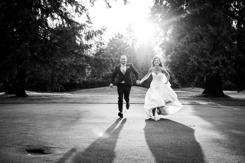 Wedding Photography, black and white of couple running hand in hand