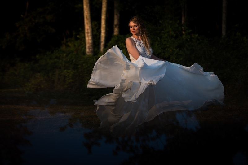 Wedding Photography, bride twirling her dress in the air