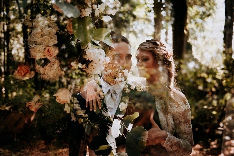 Wedding Photography, double exposure image of bride and groom and the wedding bouquet