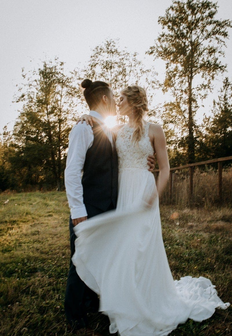 Wedding Photography, couple kissing with the sun behind them