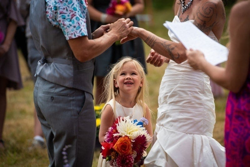 Wedding Photography, flower girl looking up at exchanging of the rings