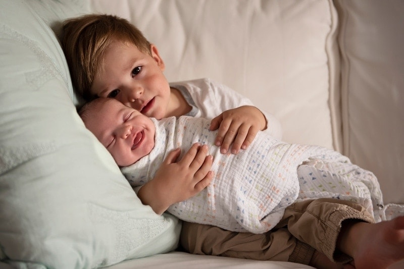 Baby Photography, baby swaddled in toddler brother's arms