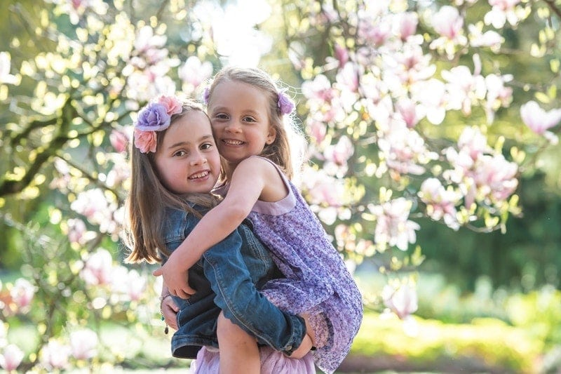 Family Photography, older sister holding up younger sister