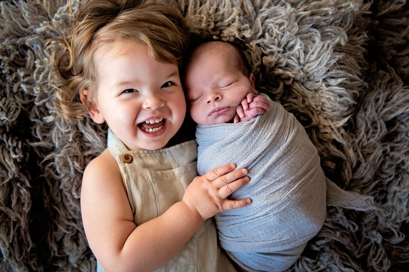 Vancouver Family Photography, little sister hugging newborn baby
