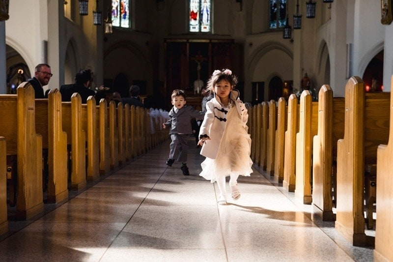 Wedding Photography, little boy and little girl walking down church aisle