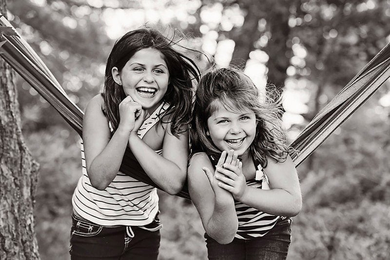 Family Photography, black and white of two little girls on hammock